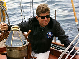 Photo of John F. Kennedy on a boat. Link to Gifts That Protect Your Assets