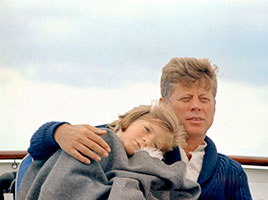 Photo of John F. Kennedy with his daughter. Link to Gifts of Life Insurance