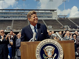 Photo of John F. Kennedy standing at a podium. Link to Gifts of Appreciated Securities