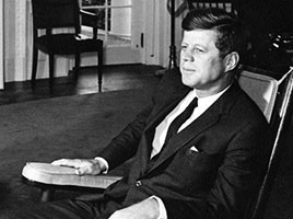 Photo of John F. Kennedy in a rocking chair. Link to What to Give